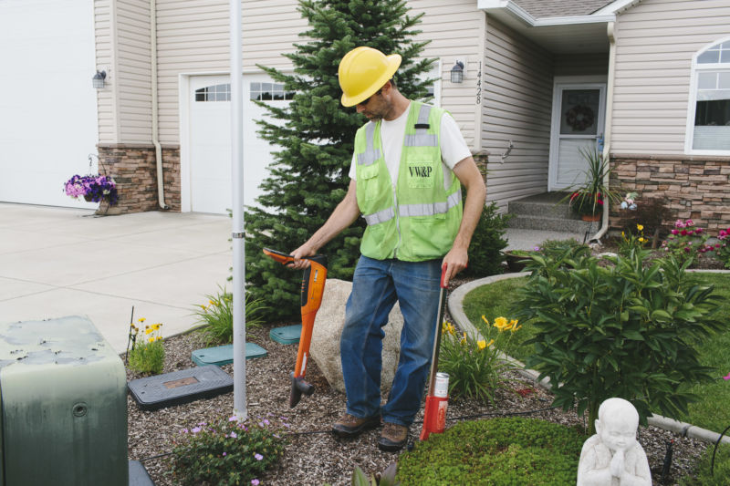 utility worker in front yard of residence