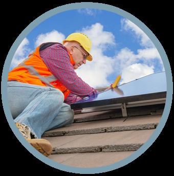 Worker installing solar panel